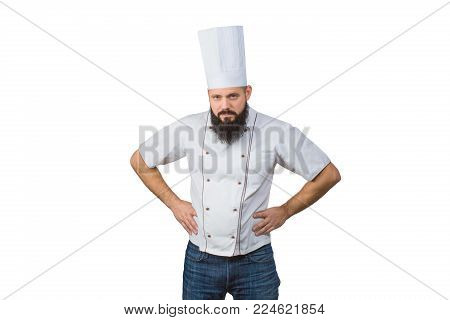 Portrait of a confident bearded chef isolated over white background. hands in the hips