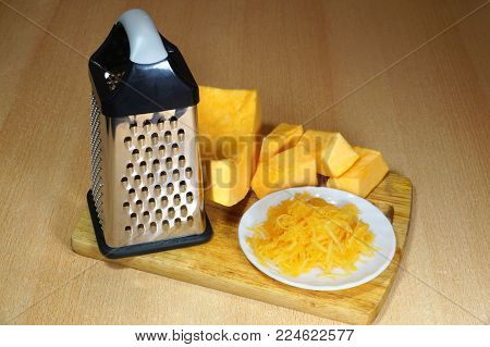 Vegetable grater, pieces of pumpkin and pumpkin take off
