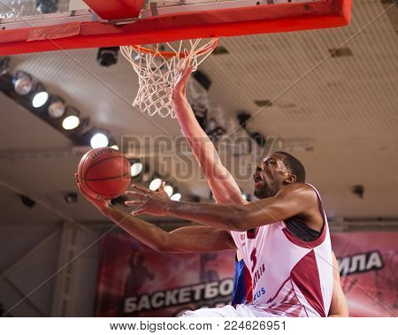 SAMARA, RUSSIA - DECEMBER 01: BC Krasnye Krylia forward Demetris Nichols (8) does a reverse layup during the BC CSKA game on December 01, 2013 in Samara, Russia.