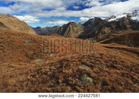 Gran Paradiso. Italian National Park. Beautiful landscape. Picture with sky. Autumn nature. Mountain landscape. Blue sky. Europe.