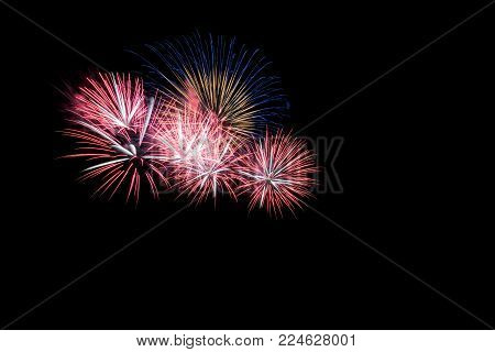 Colored Firework Background With Free Space For Text. Colorful Fireworks At Night Light Up The Sky W
