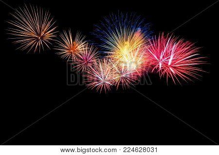 Colored firework background with free space for text. Colorful fireworks at night light up the sky with dazzling display. Use for abstract background.