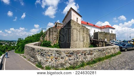 Mukachevo, Ukraine - MAY 25, 2008: panorama of Palanok Castle in summertime. Old fortification now serves as the museum and is popular tourist landmark
