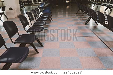 Empty waiting room at the railway station, airport, port or hall of hospital with empty chairs, copy space