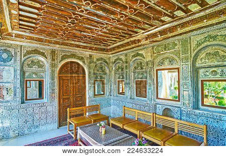 SHIRAZ, IRAN - OCTOBER 12, 2017: The medieval mirror veranda of Zinat Ol-Molk mansion serves as the restaurant hall, here visitors can relax, enjoy local cuisine and admire interior decors, on October 12 in Shiraz.