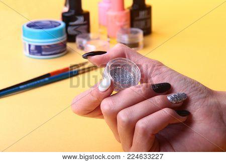 Black, white Nail art manicure. Holiday style bright Manicure with sparkles. Beauty hands. Stylish Nails, Nail Polish.