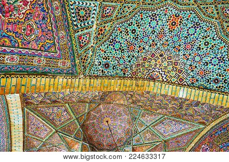 SHIRAZ, IRAN - OCTOBER 12, 2017: The tiled patterns on the complex  vault of summer prayer hall of Nasir Ol-Molk mosque, on October 12 in Shiraz.