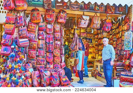 Shiraz, Iran - October 11, 2017: The  Stall In Vakil Bazaar With Ethnic Woven Bags And Backpacks, De