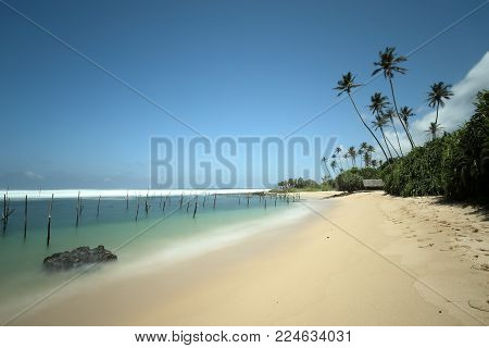 The beach at Koggala with the stilt fishermen of Sri Lanka