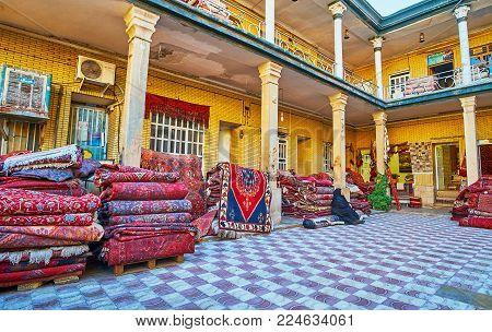Shiraz, Iran - October 12, 2017: The Heap Of Persian Carpets In Yard Of Warehouse-store, Located Nex