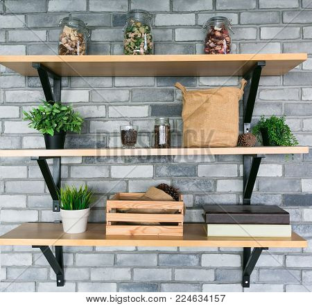 Wooden Shelves With Different Home Related Objects.