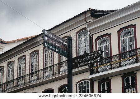 Signposts and retro-style terrace in UNESCO World Heritage City, Ouro Preto in Minas Gerais, Brazil