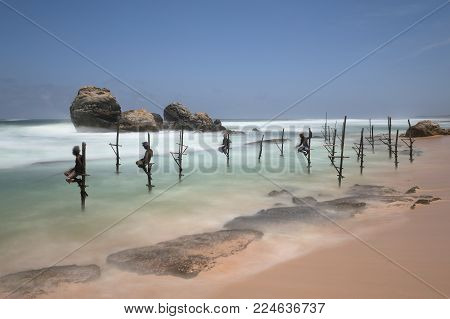 The stilt fishermen of Sri Lanka on the beach of Koggala