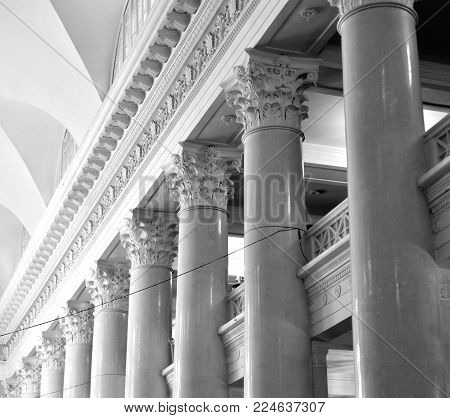 Colonnade in old building in Saint Petersburg, Russia. Black and white.