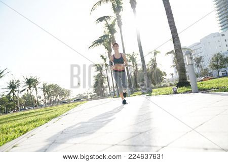 Jogger woman exercising in public park