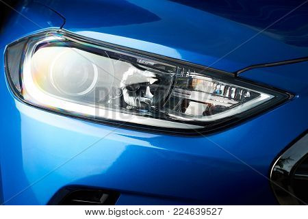 Led car headlight close-up. New modern vehicle detail of lamps light
