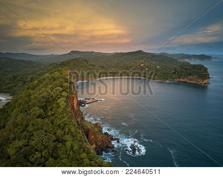 Ocean bay in sunset time aerial drone view. Nicaragua travel landscape