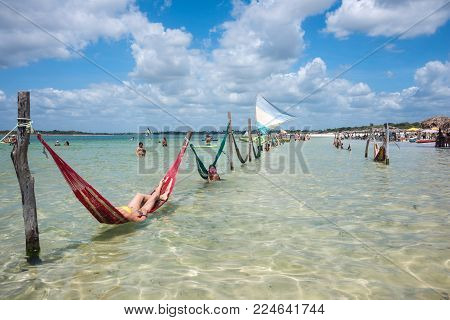 Tourists Rest On The Beach Of The Paradise Lake, Jericoacoara, Brazil