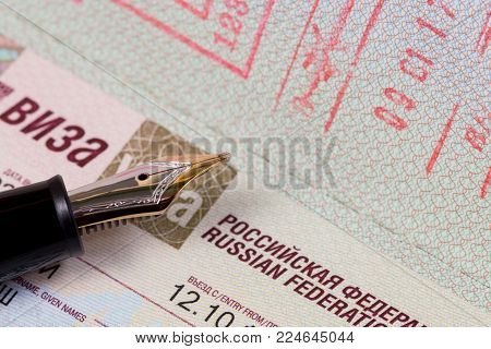 German passport to the Russian Federation with fountain pen