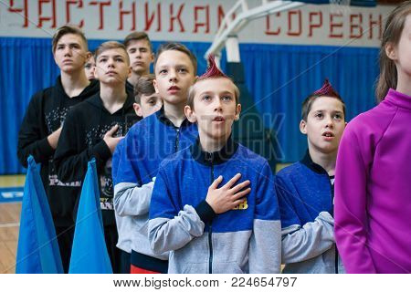 Kamenskoye, Ukraine - November 28, 2017: Young Athletes Listen To The National Anthem, сhampionship