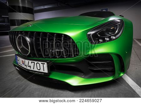 Zilina, Slovak Republik / Slovakia - November 09 , 2017: Native green colour Mercedes-AMG GT R Coupe standing at underground parking in Zilina, Slovakia