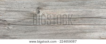 Wide panorama banner old wood background texture with cracks, woodgrain and knots in a full frame detailed view