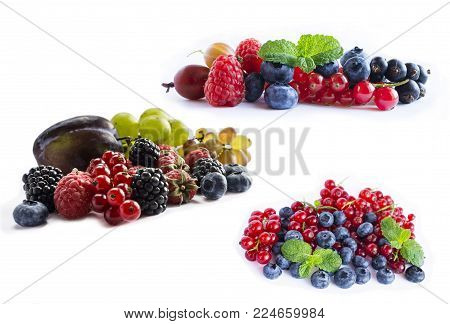 Set of fresh fruits and berries. Ripe blueberries, blackberries, red currants, grapes, raspberries and plums. Various fresh summer berries on white background. Berries and fruits with copy space for text. Background berries.