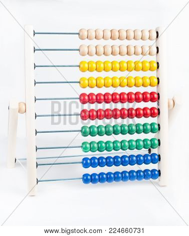 Children's multicolored wooden abacus on a white background