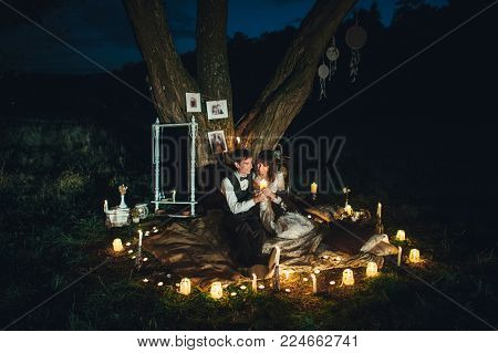 Amazing wedding couple near the river at night