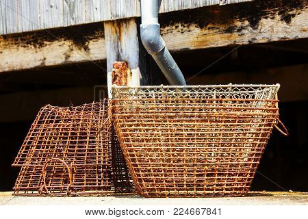 Closeup on stack of old lobster traps rusty
