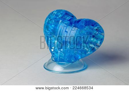 Blue cold heart as a symbol of inaccessibility close-up