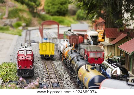 Set Of Red Electric Model Railway Locomotive And Layout With A Station And Whole Scene With Features
