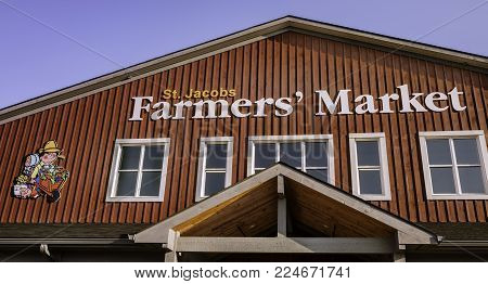 ST. JACOBS, CANADA - OCTOBER 6, 2016: Exterior upper floor of St. Jacobs Farmers' Market.  A major tourist attraction in Southwestern Ontario, farmers bring their fresh produce to sell at this market.
