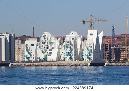 Aarhus, Denmark - May 20, 2016: View from the sea side to the residential complex Isbjerget in Aarhus, Denmark. It is belonging to a new district on the harbor area near the town center.