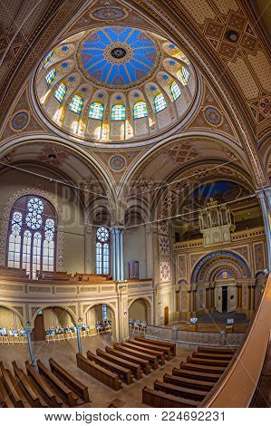 ORADEA, ROMANIA - JANUARY 27, 2018: Inside of the Neolog Synagogue Zion. Built between 1877-1878 in neo-maorical style with 1000 seats, ist the biggest of Romania and nr.3 in Europe.