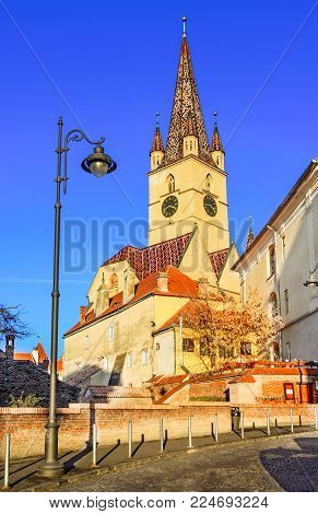 Sibiu, Romania, Transylvania. Lutheran Church, built in the Huet Square, seen from the streets of medieval Lower Town city