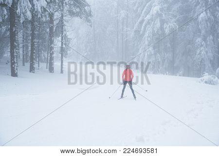 Nordic ski in white winter nature. Sport active photo
