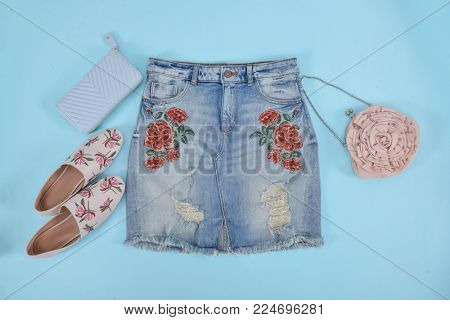 embroidery,floral,rose female Jeans skirt, shoes, bag –blue background