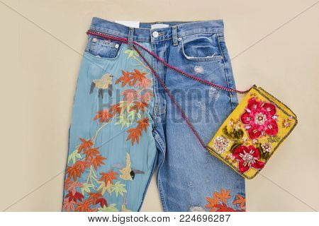 Embroidered flowers jeans, handbag - beige background
