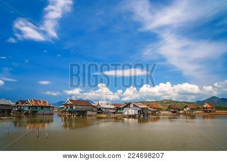 Village Containing Of Small Homes On Stilts In The Sumbava Island, Indonesia