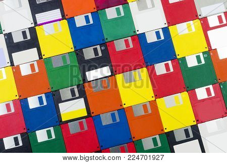 Horizontal close-up shot of a group of multicolored plastic diskettes angled left.