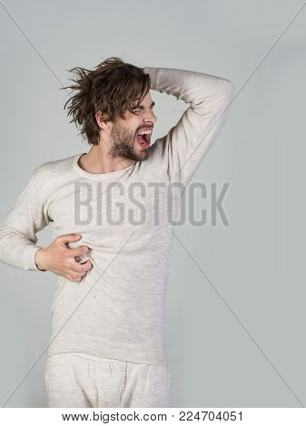 Man With Disheveled Hair In Underwear. Insomnia, Energy, Single With Uncombed Hair. Barber And Haird