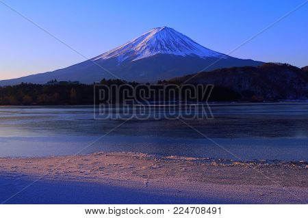 Mount Fuji on the lake frozen from Lake Kawaguchi Japan 01/31/2018