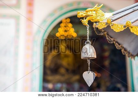 Head Of Dragon And Bell In Chinese Temple