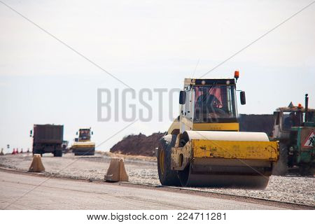 the road rollers working on the new road construction site asphalt compactor