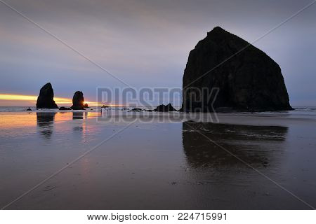 Cannon Beach Haystack Rock Pinnacles Sunset. Cannon Beach Pinnacles At Sunset, Pacific Ocean. Oregon