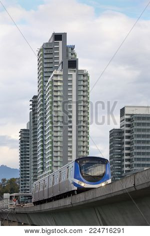 Vancouver Canada Line Transit. The Canada Line, A Rapid Transit Commuter Train, Crosses The Fraser R