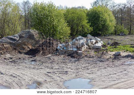 Illegal trash dump near forest