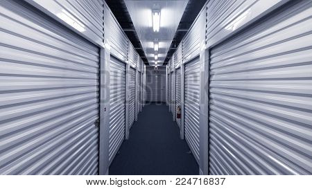 Indoor hallway of steel storage locker units.