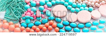 Banner Set of vintage costume jewellery beads, necklaces, bracelets, scarf. Top view flat lay